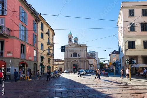 In de dag Milan Tourists and local people are crossing street near Santa Maria della Vittoria . MILAN, ITALY