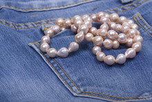 Jeans And Pearl Necklace
