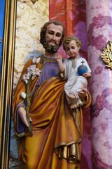 Saint Joseph holding baby Jesus statue at the altar in the church of Saint Catherine of Alexandria in Krapina, Croatia.