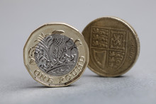New British One Pound Coin Alongside The Old Coin