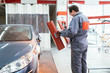 Car painting procedure at auto service store.