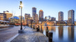 Boston Harbor in Boston, Massachusetts, USA at sunset.