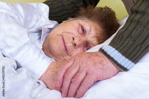 Close up bedridden woman Wallpaper Mural