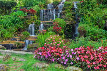 Obraz na Szklebeautiful landscaping with waterfall and flowers