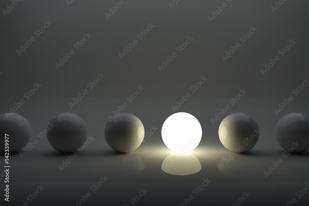 Fototapety, obrazy: One illuminater ball among grey balls in the row concept.