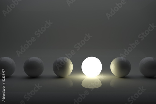 Obraz One illuminater ball among grey balls in the row concept. - fototapety do salonu