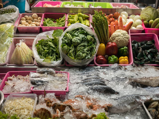 Store selling vegetables and seafood