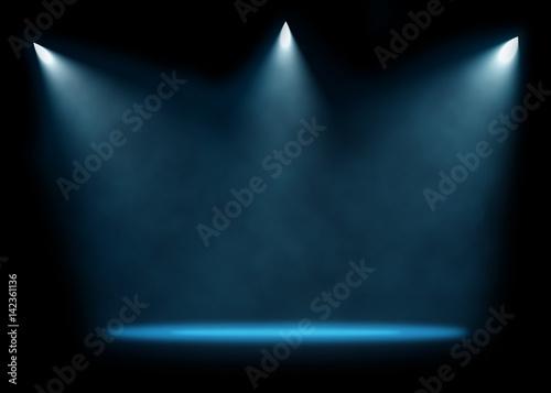 Cadres-photo bureau Lumiere, Ombre Three spotlights illuminating empty stage background.