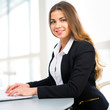 Businesswoman using laptop at office