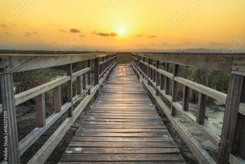 Photo Stands Night blue Wooden bridge with sunset sky in twilight at Sam Roi Yot National Park,Thailand