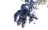 Fototapeta Space - Modern space art. Astronaut at spacewalk. Dust of universe, smoke, isolated on clear white background. Elements furnished by NASA