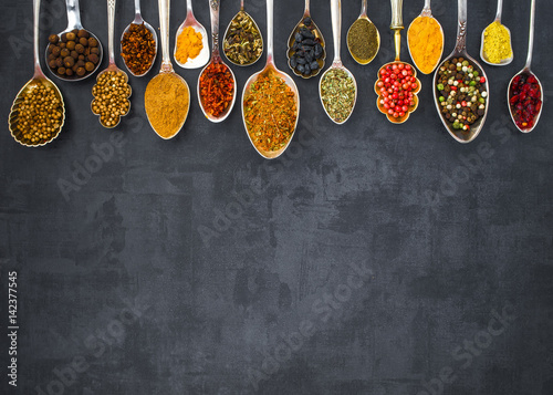 Canvas Prints Spices Various spices spoons on stone table. Top view .