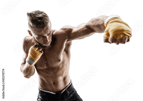 Athletic boxer throwing a fierce and powerful punch. Photo of muscular man isolated on white background. Strength and motivation.