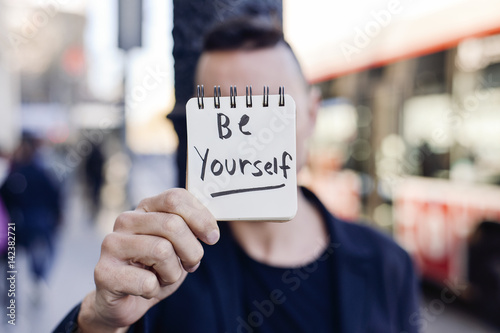 Photo  man and text be yourself in a note
