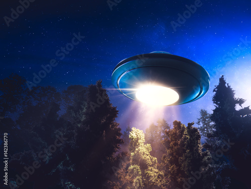 Poster de jardin UFO High contrast image of UFO flying over a forest with light beam at night