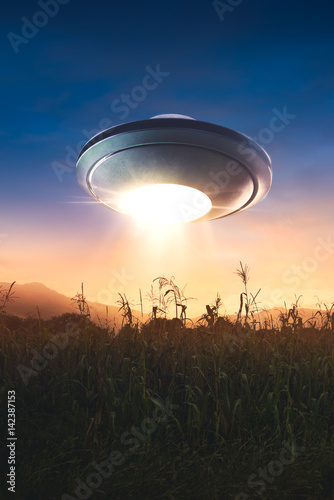 Poster UFO UFO with abduction beam flying in the sky