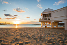 Romantic Sunset At Cadiz Beach With Famous Pier