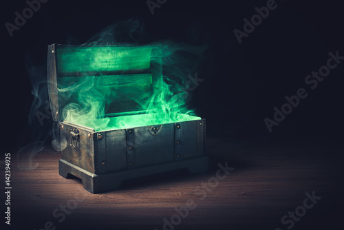Photo  open pandora's box with green smoke on a wooden background /high contrast image