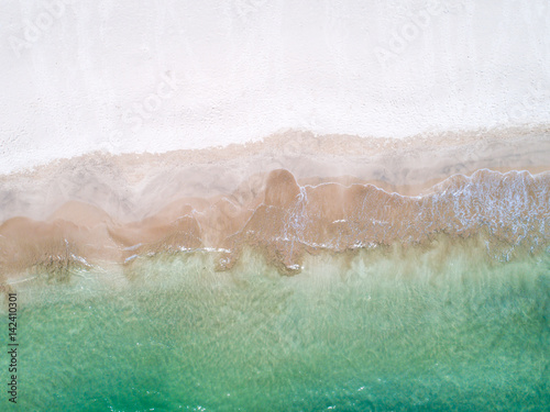 beach with sea and palm taken from drone