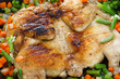 Whole grilled chicken with vegetables in a frying pan