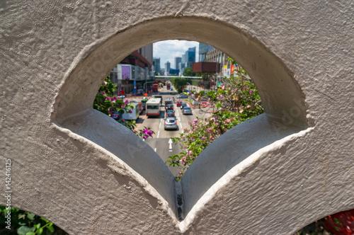 Peering at urban traffic through building design element Poster