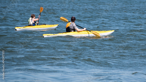 Poster Water Motor sports People are playing kayak in a lake