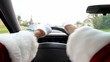 POV of person driving. Road rage point of view. Person wearing santa claus costume and driving