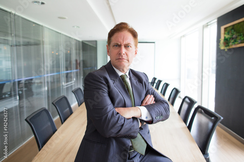 Fotografía Portrait of stern senior businessman in boardroom