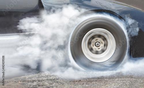 Cadres-photo bureau Motorise Drag racing car burns rubber off its tires for the race