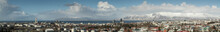 Panorama Of Reykjavik Skyline Showing Hallgrimskirkja Church Cathedral And The Mountains In The Background.