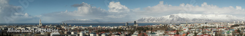 Fotografia, Obraz Panorama of Reykjavik skyline showing Hallgrimskirkja church cathedral and the mountains in the background