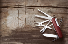 Old Swiss Knife On A Wooden Background