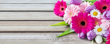 Flowers And Wooden Background