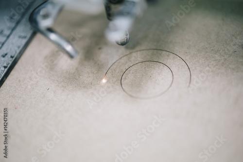 Fotografie, Obraz  Industrial laser engraving on a paperboard