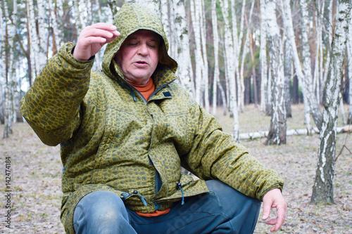 Valokuva  Mature caucasian man in the spring forest
