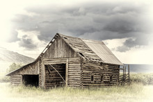 Old Rustic Log Barn In Rocky Mountains