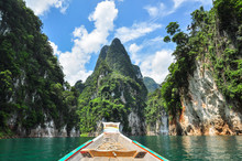 Huge Limestone Cliffs Rising Out Of Open Lake At Khao Sok National Park, Ratchaprapha Dam In Surat Thani Province, Thailand.