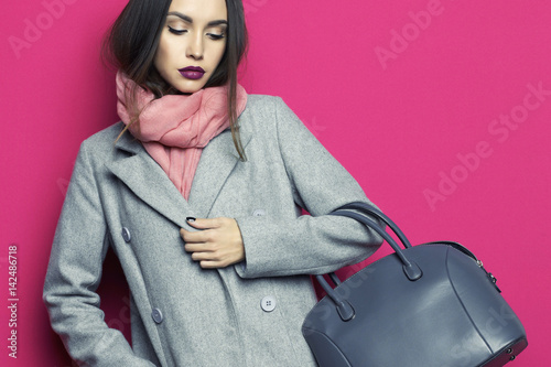 Young stylish woman in grey coat