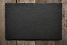 Black Slate Tile On Wooden Bac...