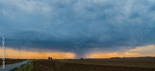 Fototapeta Huge clouds with sunset. obraz na płótnie