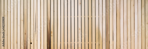 Fotografie, Obraz  Wooden slats on floor or wall in vertical parallel pattern, background panel tex