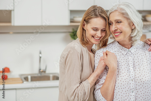 Stampa su Tela Cute young daughter embracing her mother with love