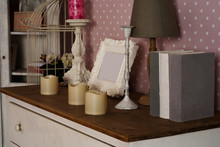 Chest Of Drawers With Books, Lamp, Photo Frame And Candles