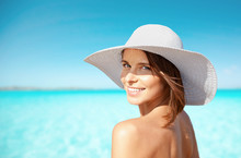 Smiling Young Woman In Sun Hat On Summer Beach