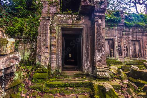 фотография  October 11, 2014: Ancient door in the Ta Prohm temple in Siem Reap, Cambodia