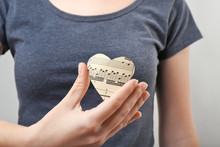 Woman Holding Paper Heart With...