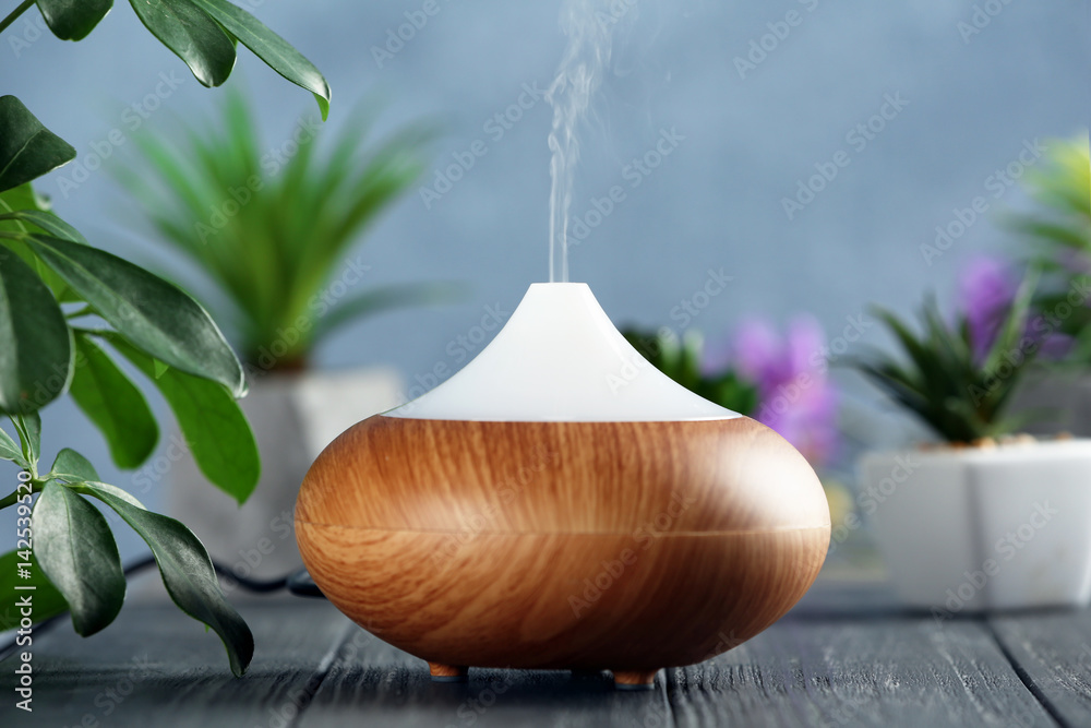 Fototapety, obrazy: Aroma oil diffuser on wooden table