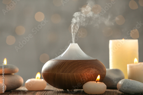 Fotografie, Obraz  Aroma oil diffuser and candles on blurred background