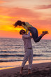 Young couple having fun on a sandy coast