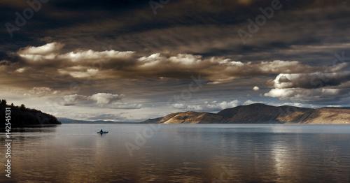 Fotografie, Obraz  Kayaker On Open Lake | Stormy Clouds Moody